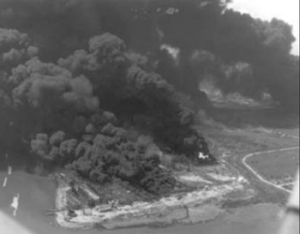 an aerial photograph of a fire on the S.S. Grand Camp anchored off Texas City, TX