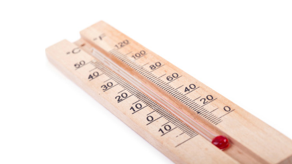 A thermometer with Celsius and Farenheit scales.